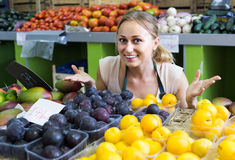 Woman  holding ripe plums Stock Photo