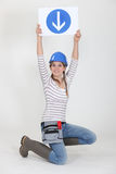 Woman holding road sign Stock Images