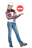 Woman holding a road sign. Royalty Free Stock Image