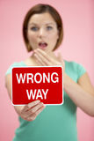 Woman Holding Road Traffic Sign Royalty Free Stock Photos