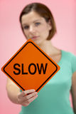 Woman Holding Road Traffic Sign Stock Images
