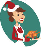 Woman holding roasted christmas turkey Stock Photography