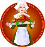 Woman holding a roasted turkey on a plate Stock Image