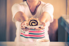 Woman holding with roll cake Royalty Free Stock Photography