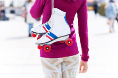 Woman holding roller-skates Stock Photography
