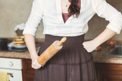 Woman holding rolling pin in kitchen Royalty Free Stock Photos