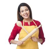 Woman holding rolling pin and wooden spoon Royalty Free Stock Images