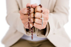 Woman holding rosary beads. Midsection of woman holding rosary beads stock images