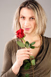 Woman holding rose. Young woman holding red rose Royalty Free Stock Image