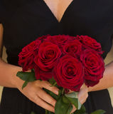 Woman holding roses Stock Photos