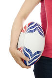 Woman holding rugby ball. In hand against white background stock image