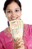 Woman holding rupee notes Stock Photography