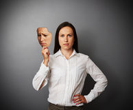 Woman holding sad mask. Young woman holding sad mask Stock Images