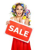 Woman holding sale banner and flower. Isolated Stock Photos
