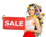 Woman holding sale banner and flower. Stock Photo
