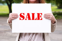 Woman holding a sale sign Stock Photo