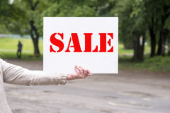 Woman holding a sale sign Stock Photos