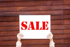 Woman holding a sale sign Stock Image