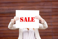 Woman holding a sale sign Royalty Free Stock Images