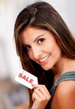 Woman holding a sale tag Royalty Free Stock Image