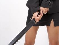 Woman holding samurai. Closeup image of woman holding samurai in black clothing stock photos