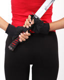 Woman holding samurai. Closeup image of woman holding samurai in red and black clothing stock image