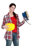 Woman holding a sander Royalty Free Stock Image