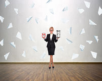Woman holding sandglass and alarm clock Royalty Free Stock Images