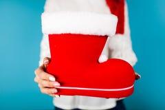 Woman holding Santa`s shoe Stock Photo