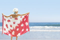 Woman Holding Sarong On Beach Royalty Free Stock Photos