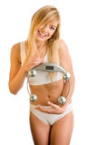 Woman holding a scale Stock Photos