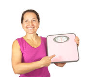 Woman holding scale Royalty Free Stock Images