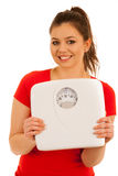 Woman holding a scale isolated over white background Stock Image