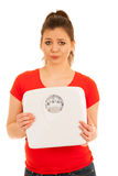 Woman holding a scale isolated over white background Stock Photo