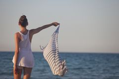 Woman holding scarf at the beach Royalty Free Stock Photos