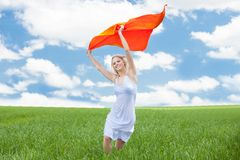 Woman Holding Scarf Running In Field Stock Image