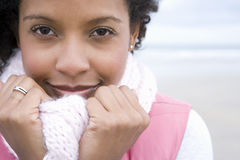 Woman holding scarf to face, smiling, portrait, close-up Stock Photo