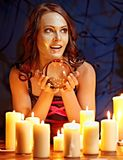 Woman holding scrying ball . Woman holding scrying ball and candle Stock Photos