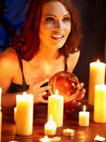 Woman holding scrying ball . Royalty Free Stock Photo