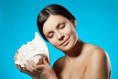Woman holding seashell Stock Photos