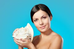 Woman holding seashell Stock Images