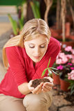 Woman holding seedling with soil Stock Images