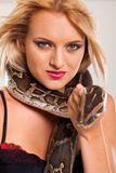 Woman holding serpent Royalty Free Stock Photography