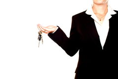 Woman holding set of keys. Anonymous woman, dressed in a casual, dark suit, holding a set of keys in her hand...isolated view Stock Photos