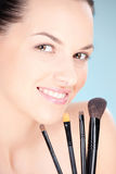 Woman holding set of make up brushes Stock Photos