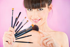 Woman holding set of make up brushes Royalty Free Stock Image