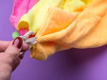 Woman holding set of microfiber cloths. Woman hand holding set of microfiber cloths Stock Photos