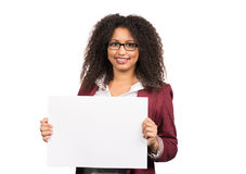 Woman is holding a sheet of paper Royalty Free Stock Images