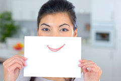 Woman Holding Sheet Paper Over Mouth Stock Photos
