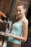 Woman holding shoe Stock Photo